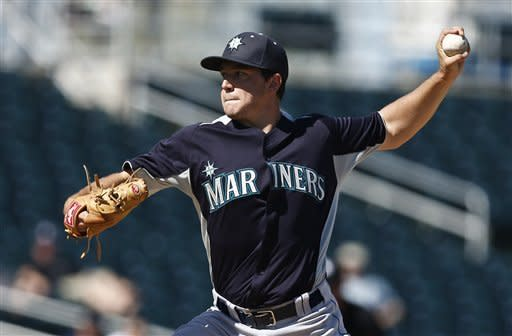 Seattle Mariners' Danny Hultzen throws a pitch against the Cleveland Indians in the second inning during an exhibition spring training baseball game, Wednesday, Feb. 27, 2013, in Goodyear, Ariz. (AP Photo/Ross D. Franklin)