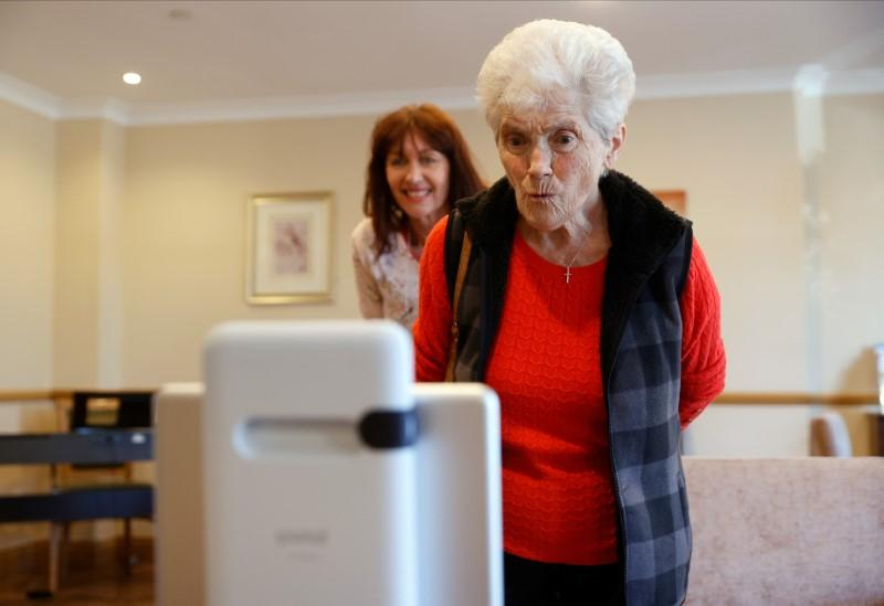Resident Copping chats via Facebook Portal to her daughter at the Foxholes Care Home