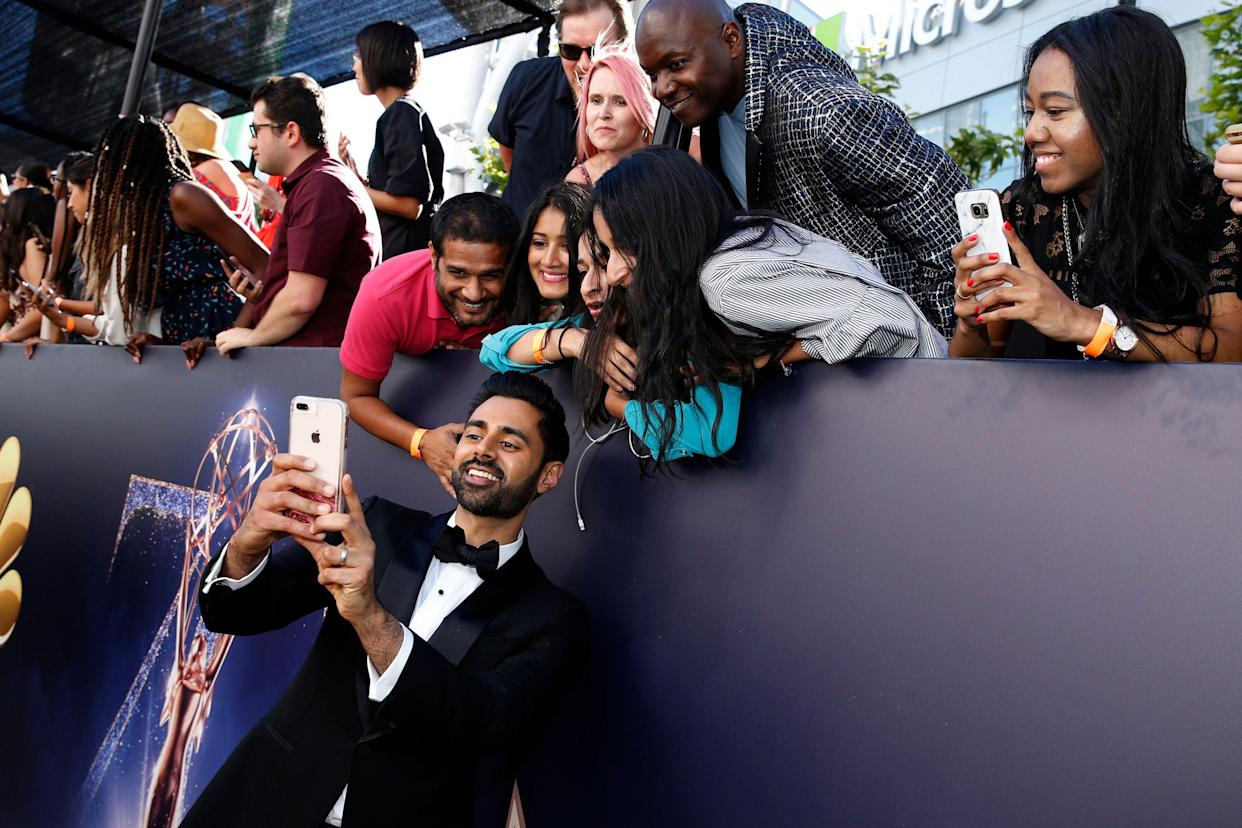 Hasan Minhaj arrives at the 70th Primetime Emmy Awards on Monday, Sept. 17, 2018, at the Microsoft Theater in Los Angeles. (Photo by Eric Jamison/Invision for the Television Academy/AP Images)