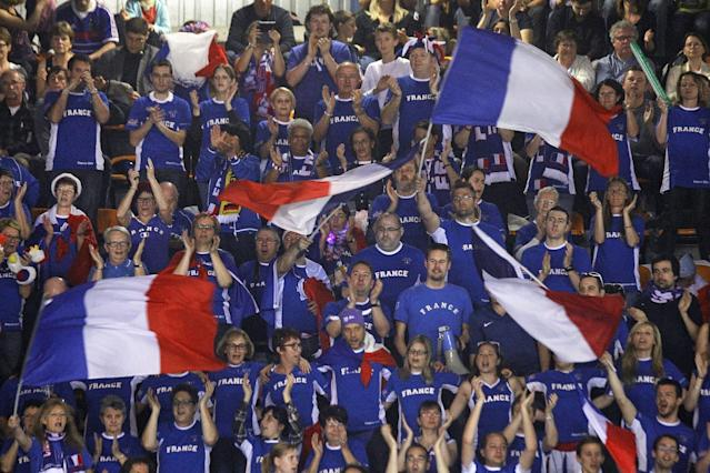 French supporters encourage their team, during the double match between French players Michael Llodra, Julien Benneteau, and German pair Andre Begemann, Tobias Kamke, in the quarterfinals of the Davis Cup between France and Germany, in Nancy, eastern France, Saturday April 5, 2014.(AP Photo/Remy de la Mauviniere)