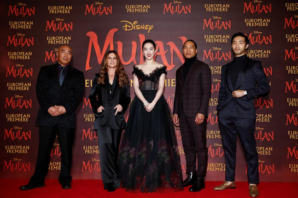 """Cast members Ron Yuan, Yifei Liu, Jason Scott Lee and Yoson An pose with director Niki Caro, at the European premiere for the film """"Mulan"""" in London, Britain March 12, 2020."""
