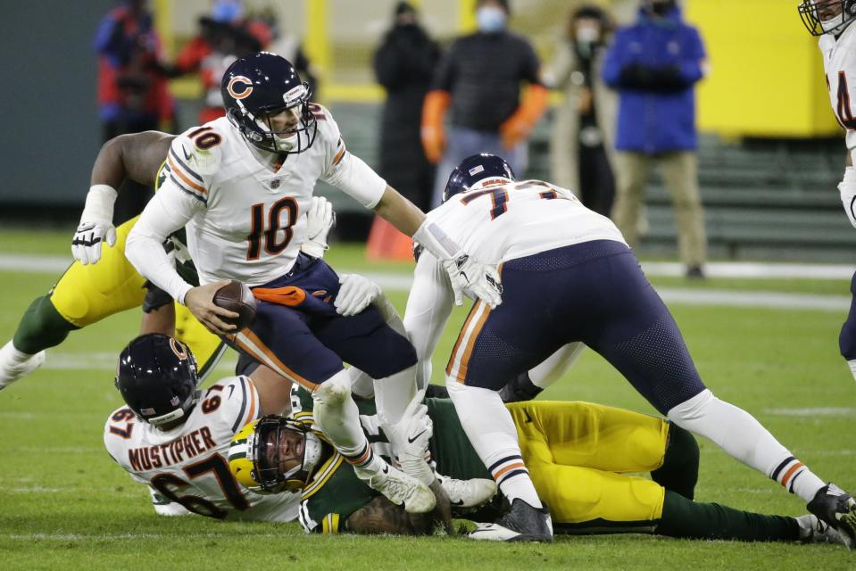 Chicago Bears' Mitchell Trubisky is sacked by Green Bay Packers' Preston Smith during the second half of an NFL football game Sunday, Nov. 29, 2020, in Green Bay, Wis. (AP Photo/Mike Roemer)