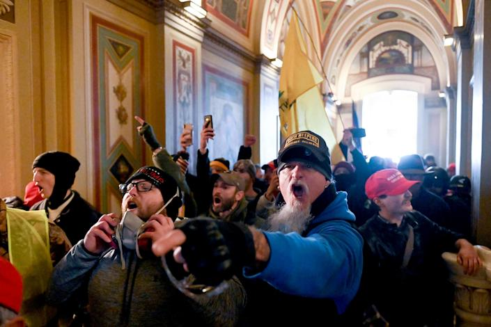 Image: Supporters of President Donald Trump protest inside the Capitol on Jan. 6, 2021. (Roberto Schmidt / AFP - Getty Images file)