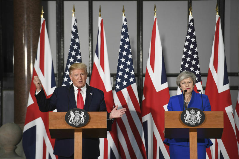 "Britain's Prime Minister Theresa May and US President Donald Trump take part in a joint press conference at the Foreign & Commonwealth Office, in London, Tuesday June 4, 2019. Moving from pageantry to policy during his state visit to Britain, President Donald Trump on Tuesday urged embattled Prime Minister Theresa May to ""stick around"" to complete a U.S.-U.K. trade deal, adding to this recent chapter of uncertainty in the allies' storied relationship. (Stefan Rousseau/Pool via AP)"