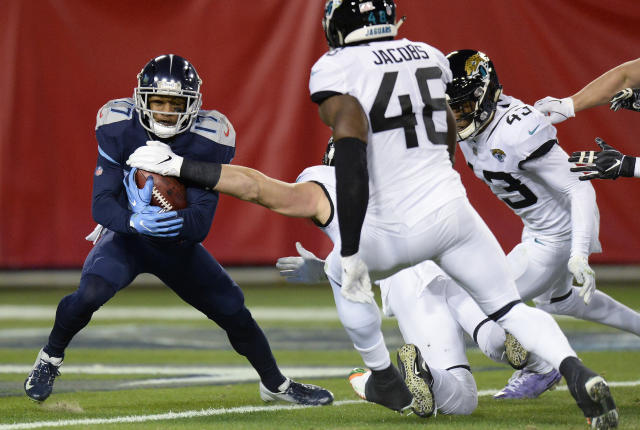 Tennessee Titans wide receiver Cameron Batson (17) holds on the ball before he is tackled in the end zone for a Safety against the Jacksonville Jaguars during the first half of an NFL football game, Thursday, Dec. 6, 2018, in Nashville, Tenn. (AP Photo/Mark Zaleski)
