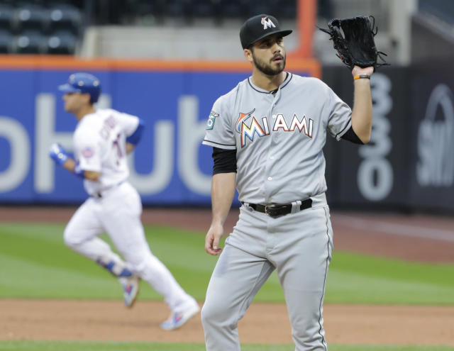 tackles Miami Marlins relief pitcher Kyle Barraclough, right, reacts as New York Mets' Michael Conforto (30) runs the bases after hitting a home run during the ninth inning of the first baseball game of a doubleheader Thursday, Sept. 13, 2018, in New York. (AP Photo/Frank Franklin II)