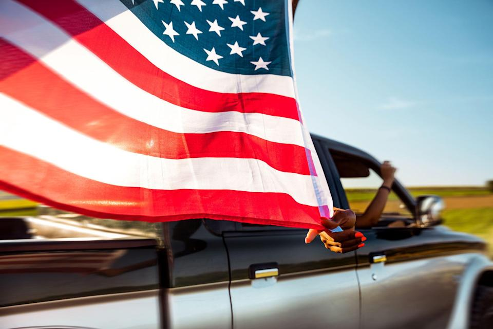 """<p>In celebration of our great nation's birth, or just as a general act of patriotism, many American motorists choose to display the Stars and Stripes as a decal or an actual flag on <a href=""""https://www.caranddriver.com/features/g22639636/most-american-cars-and-trucks-you-can-buy/"""" rel=""""nofollow noopener"""" target=""""_blank"""" data-ylk=""""slk:their car, truck, or motorcycle"""" class=""""link rapid-noclick-resp"""">their car, truck, or motorcycle</a>. Some automakers have released special editions of their vehicles that already have the flag displayed in the appropriate way, <a href=""""https://www.caranddriver.com/news/a27112921/2019-dodge-challenger-charger-stars-stripes-edition/"""" rel=""""nofollow noopener"""" target=""""_blank"""" data-ylk=""""slk:like this Dodge Challenger"""" class=""""link rapid-noclick-resp"""">like this Dodge Challenger</a>, but for those who'd like to add their own flags, it's good to know the proper etiquette. </p><p>These <a href=""""https://www.collinsflags.com/etiquette.cfm"""" rel=""""nofollow noopener"""" target=""""_blank"""" data-ylk=""""slk:specific rules"""" class=""""link rapid-noclick-resp"""">specific rules</a> and best practices for flying the American flag should be considered before you place your decals, stickers, or fabric flags, so we've put together some simple guidelines for you with thanks to the American Legion and several <a href=""""https://www.flagandbanner.com/flags/flag_etiquette.asp"""" rel=""""nofollow noopener"""" target=""""_blank"""" data-ylk=""""slk:flag dealers"""" class=""""link rapid-noclick-resp"""">flag dealers</a> that publish <a href=""""https://www.flagsoncars.com/flagetiquette.html?gclid=EAIaIQobChMI8q-viJqU4wIVj7bACh23yghVEAEYASAAEgJsbvD_BwE"""" rel=""""nofollow noopener"""" target=""""_blank"""" data-ylk=""""slk:rules of flag etiquette"""" class=""""link rapid-noclick-resp"""">rules of flag etiquette</a>.</p><p>A single flag should fly from the right (passenger) side of the vehicle. If two flags are displayed, it's okay to put one on each side, but they should be mounted at the same height and be hung in the same way. </p><p>T"""