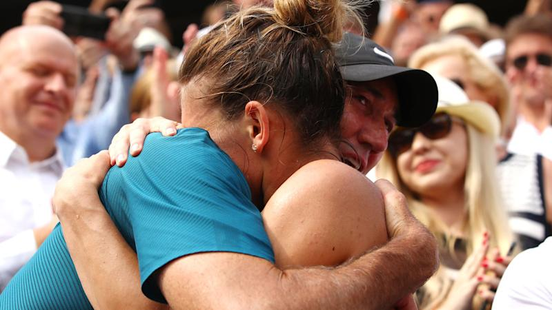 Simona Halep pictured embracing Darren Cahill after winning her first major, the 2018 French Open. Pic: Getty