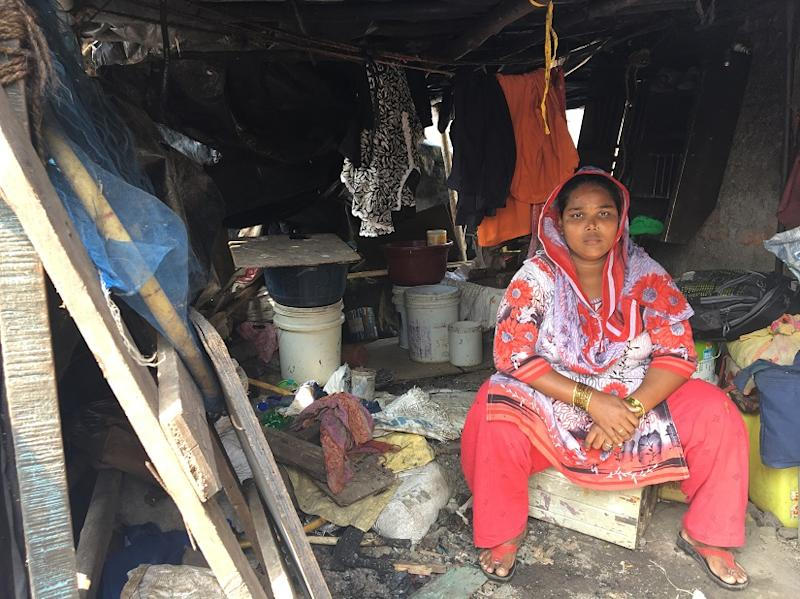 Imran Syed's wife, a new mother' sits in her shanty.