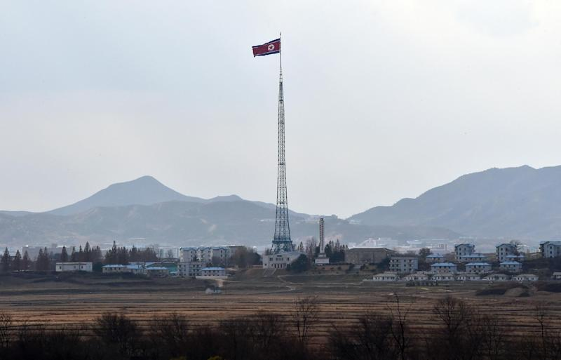 A North Korean flag flutters in the propaganda village of Gijungdong on November 12, 2014 (AFP Photo/Jung Yeon-Je)