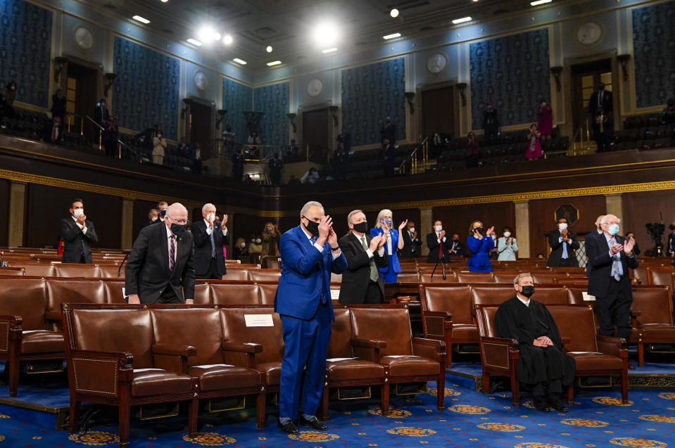 Senate Majority Leader Chuck Schumer of N.Y., stands and applauds as President Joe Biden addresses a joint session of Congress, Wednesday, April 28, 2021, in the House Chamber at the U.S. Capitol in Washington. (Melina Mara/The Washington Post via AP, Pool)