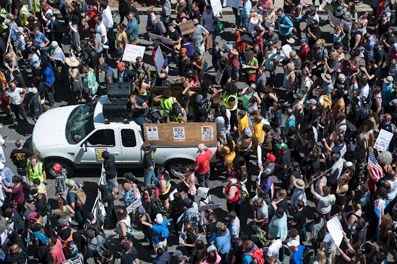 Officials estimated turnout of about 40,000 demonstrators -- with only a few dozen far-right activists (AFP Photo/Ryan McBride)