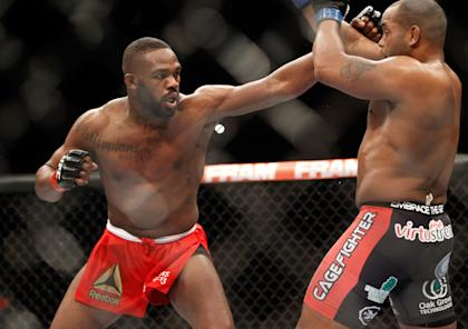 Jon Jones punches at Daniel Comier during his last title defense in January. (Getty)