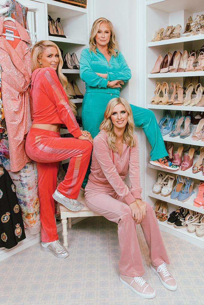 The Hiltons in customized matching Juicy Couture velour tracksuits. From left: Paris in Philipp Plein crystal-studded sneakers, Kathy in New Balance sneakers and Nicky in Malone Souliers Deon leather sneakers. - Credit: CAMRAFACE