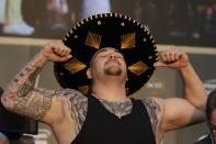 """Heavyweight boxer Andy Ruiz Jr. of Mexico poses during a weigh-in at Faisaliah Center, in Riyadh, Saudi Arabia, Friday, Dec. 6, 2019. The first ever heavyweight title fight in the Middle East, has been called the """"Clash on the Dunes."""" Will take place at the Diriyah Arena on Saturday. (AP Photo/Hassan Ammar)"""