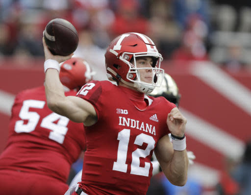 FILE - In this Saturday, Nov. 24, 2018, file photo, Indiana quarterback Peyton Ramsey throws during the first half of an NCAA college football game against Purdue, in Bloomington, Ind. Coach Tim Allen's biggest decision will be choosing a quarterback. Peyton Ramsey has made 16 starts over the last two seasons and will be seriously challenged by redshirt freshman Michael Penix Jr., who is coming back from a torn anterior cruciate ligament, and Jack Tuttle, who transferred from Utah.(AP Photo/Darron Cummings, File)