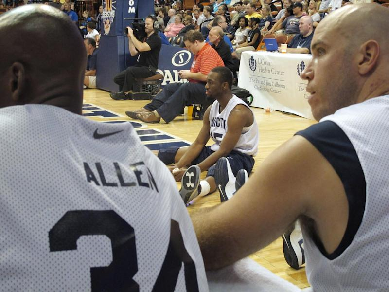 Charlotte Bobcats guard Kemba Walker, middle, waits to enter the Jim Calhoun Celebrity Classic as Miami Heat guard Ray Allen and former Connecticut player Ed Nelson sit nearby, Saturday, Aug. 4, 2012, in Uncasville, Conn. (AP Photo/Pat Eaton-Robb)
