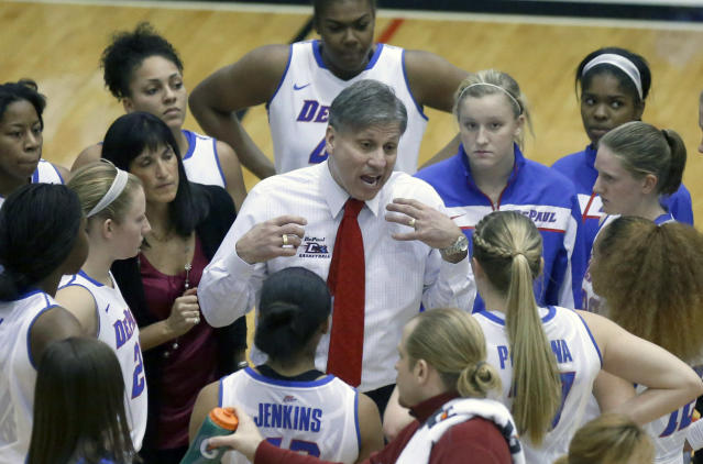 DePaul head coach Doug Bruno, center, talks with his team during the second half of an NCAA college basketball game against Kentucky Thursday, Dec. 12, 2013, in Chicago. Kentucky won 96-85. (AP Photo/Charles Rex Arbogast)