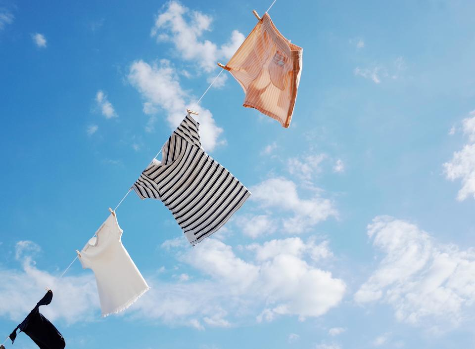 Blowing Hung out to dry cloths in the bright sky and warm sun