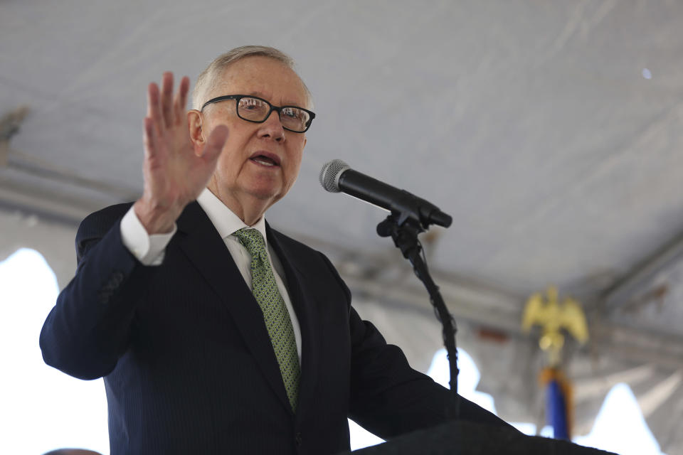 Harry Reid addresses a small crowd at the commissioning of the 179 megawatt (MW) Switch Station 1 and Switch Station 2 Solar Projects north of Las Vegas on Monday, Dec. 11, 2017. (Michael Quine/Las Vegas Review-Journal via AP)