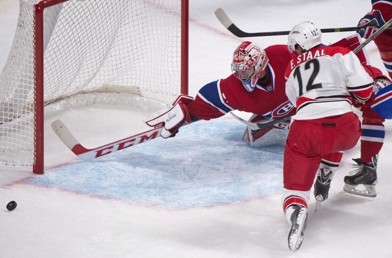 Montreal Canadiens goaltender Carey Price, left, makes a save against Carolina Hurricanes' Eric Staal during the second period of a preseason NHL hockey game in Montreal, Saturday, Sept. 21, 2013. (AP Photo/The Canadian Press, Graham Hughes)