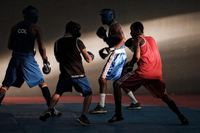 Boxers fear a knockout blow at the IOC meeting in Tokyo (AFP Photo/YASUYOSHI CHIBA)