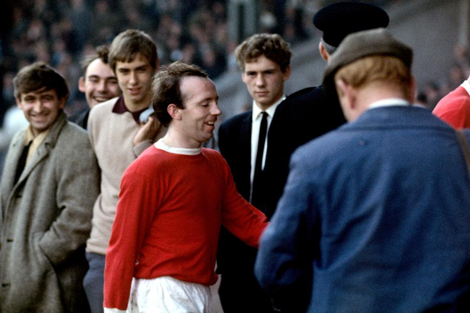 Manchester United's Nobby Stiles smiles to himself as he walks off the pitch at half-time (Photo by PA Images via Getty Images)
