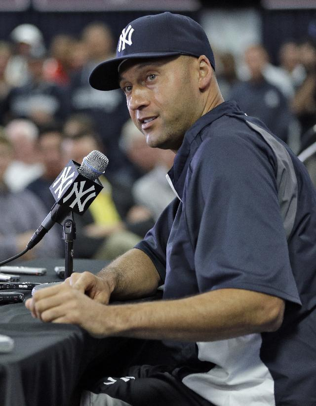 New York Yankees shortstop Derek Jeter answers during a news conference Wednesday, Feb. 19, 2014, in Tampa, Fla. Jeter has announced he will retire at the end of the 2014 season. (AP Photo/Chris O'Meara)