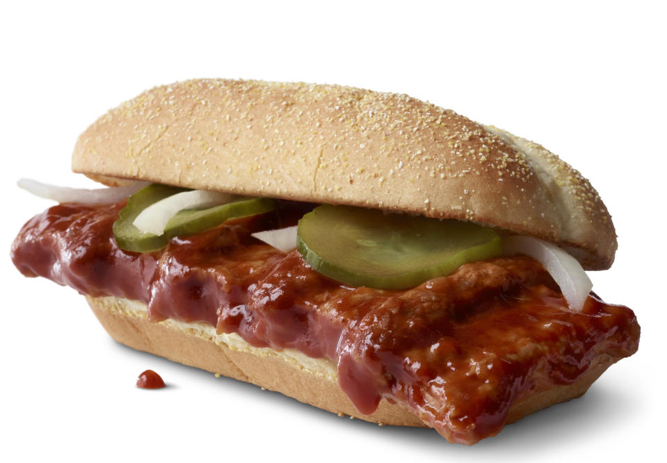 This photo provided by McDonald's shows the McRib sandwich. McDonald's announced that it was bringing its barbeque slathered sandwich with the cult following back for yet another run on Dec. 2. The fast-food giant said the sandwich would be available nationally for the first time since 2012, but only at participating restaurants for a limited time. (McDonald's via AP)