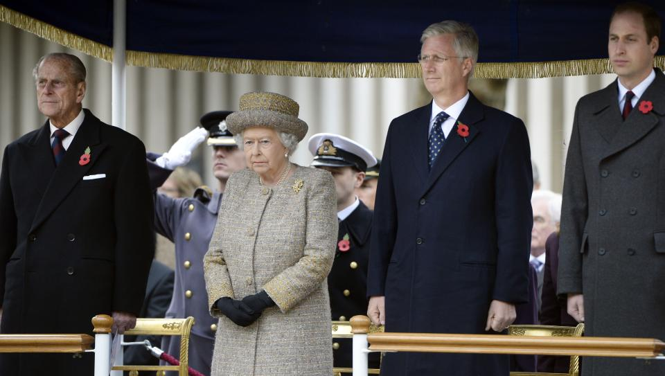 FILE - In this Thursday, Nov. 6, 2014 file photo, from left, Britain's Prince Philip and Queen Elizabeth stand with Belgium's King Philippe and Britain's Prince William during the opening of the Flanders' Fields Memorial Garden at Wellington Barracks in London. Prince Philip's life spanned just under an entire century of European history. His genealogy was just as broad, with Britain's longest-serving consort linked by blood and marriage to most of the continent's royal houses. (AP Photo/Eric Lalmand, File)