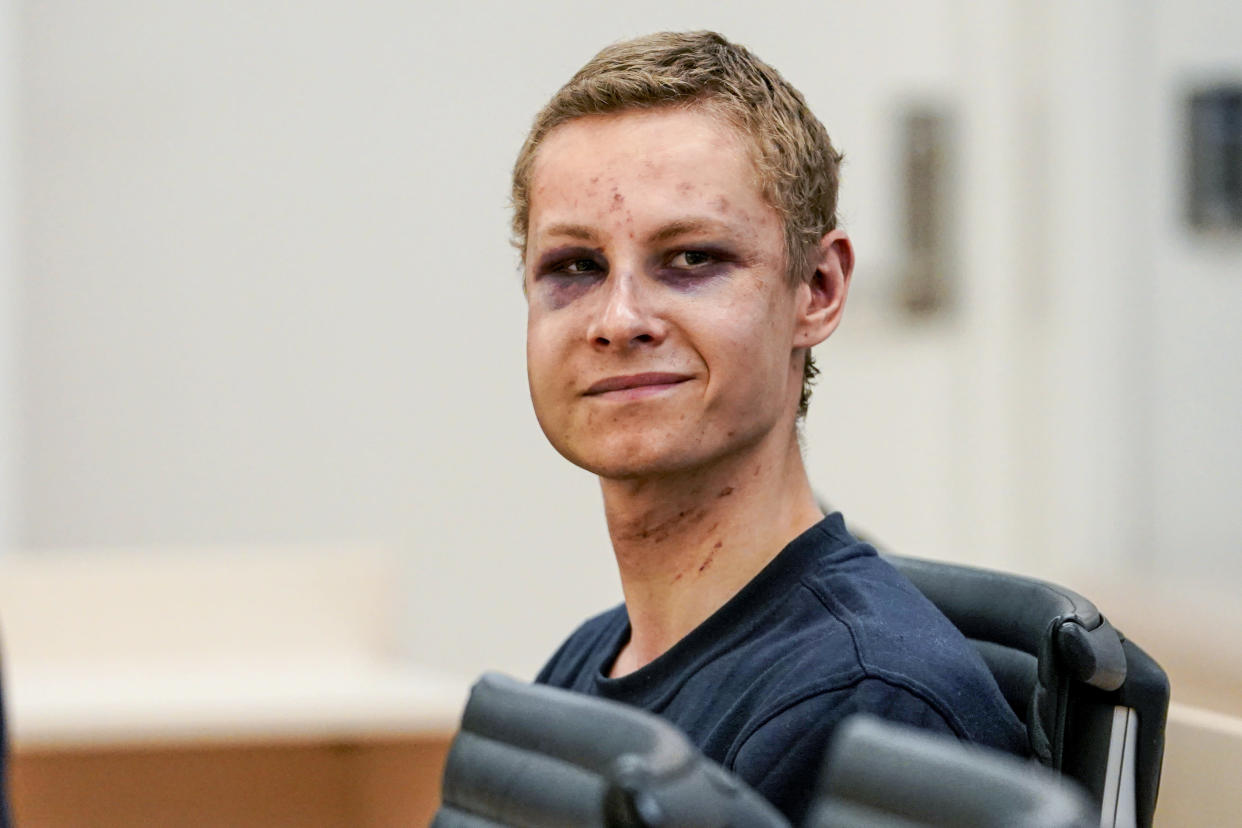 "Suspected gunman Philip Manshaus appears in court, in Oslo, Norway, Monday, Aug. 12, 2019. A suspected gunman accused of an attempted terrorist attack on an Oslo mosque and separately killing his teenage stepsister ""will use his right not to explain himself for now"" in a detention hearing, his defense lawyer said Monday. (Cornelius Poppen, NTB scanpix via AP)"