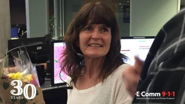 Sue Mitchell started her career as a 911 dispatcher in 1991 and celebrated 30 years on the job this week, saying she feels lucky to have been on the receiving end for people in need during those three decades. (twitter.com/EComm911_info - image credit)