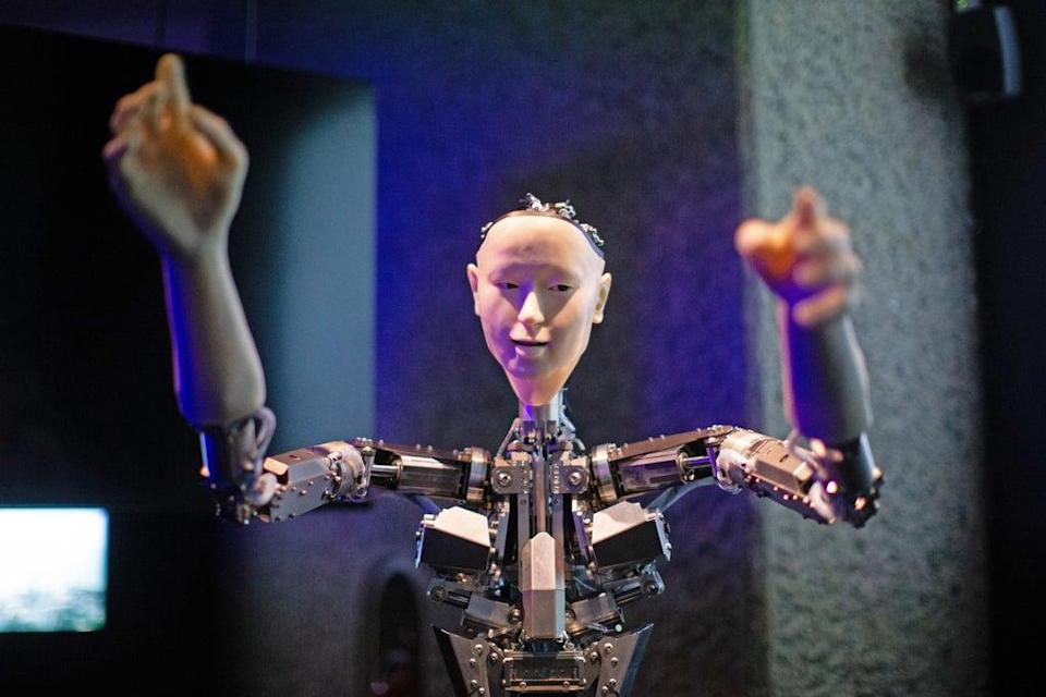 Roboticist Hiroshi Ishiguro's 'Alter', a machine body with a human like face and hands who learns through interplaying (Aaron Chown/PA) (PA Archive)