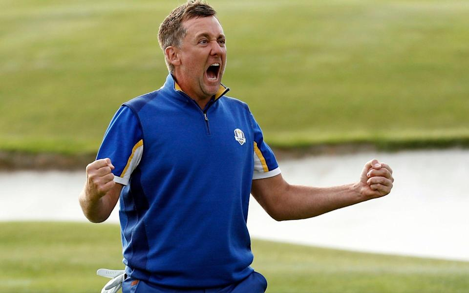 In this Sept. 30, 2018, file photo, Europe's Ian Poulter celebrates after defeating Dustin Johnson of the United States during a singles match on the final day of the 42nd Ryder Cup at Le Golf National in Saint-Quentin-en-Yvelines, France - AP