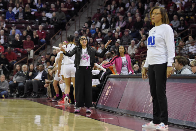 South Carolina head coach Dawn Staley, back center, and LSU head coach Nikki Fargas, front right, react during the first half of an NCAA college basketball game Thursday, Feb. 20, 2020, in Columbia, S.C. (AP Photo/Richard Shiro)