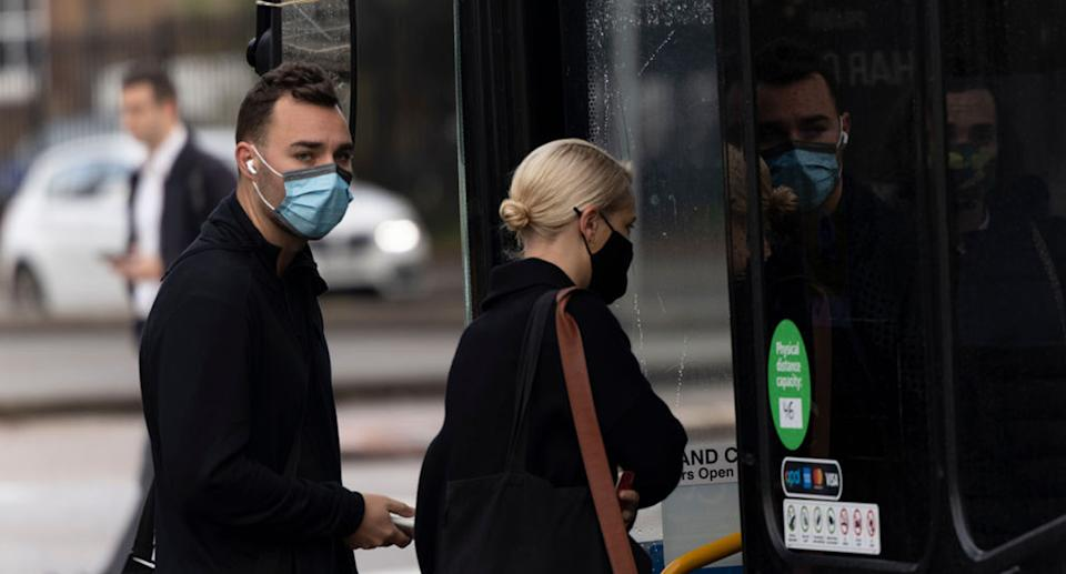 Sydneysiders are required to wear face masks on public transport. Source: Getty