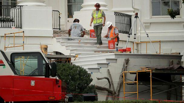PHOTO: Workers repair the South Portico steps, part of a large renovation project at the White House August 11, 2017 in Washington, DC. (Chip Somodevilla/Getty Images)