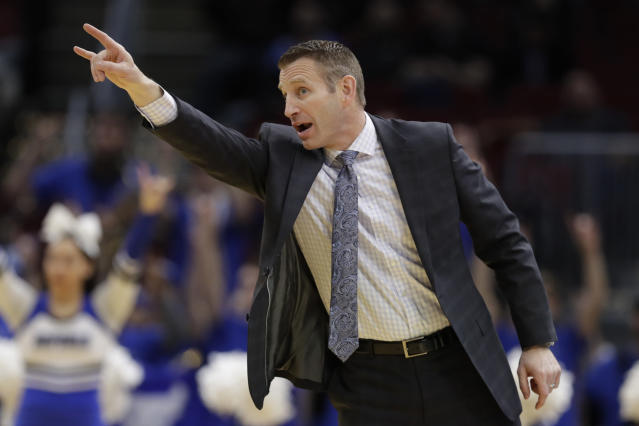 Buffalo head coach Nate Oats yells instruction to players during the first half of an NCAA college basketball game against Akron at the Mid-American Conference tournament, Thursday, March 14, 2019, in Cleveland. Buffalo won 82-46. (AP Photo/Tony Dejak)