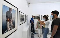 """For the exhibition being held close to where he was born, he chose """"emblematic photos ... always framed, geometric and always inhabited"""" by people. (AFP/FETHI BELAID)"""