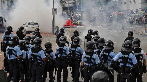 PHOTO: Protesters run away from riot police firing tear gas outside the Legislative Council during a massive demonstration in Hong Kong, Wednesday, June 12, 2019. (AP Photo/Vincent Yu)