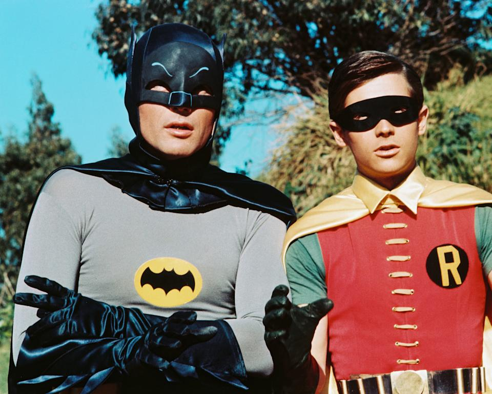 American actors Adam West as Bruce Wayne/Batman and Burt Ward as Dick Grayson/Robin in the TV series 'Batman', circa 1966.  (Photo by Silver Screen Collection/Hulton Archive/Getty Images)