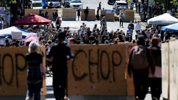 PHOTO: People walk between concrete barriers newly installed by the city as protesters demonstrate against racial inequality and occupy space at the CHOP area near the Seattle Police Department's East Precinct in Seattle, June 16, 2020. (Lindsey Wasson/Reuters)