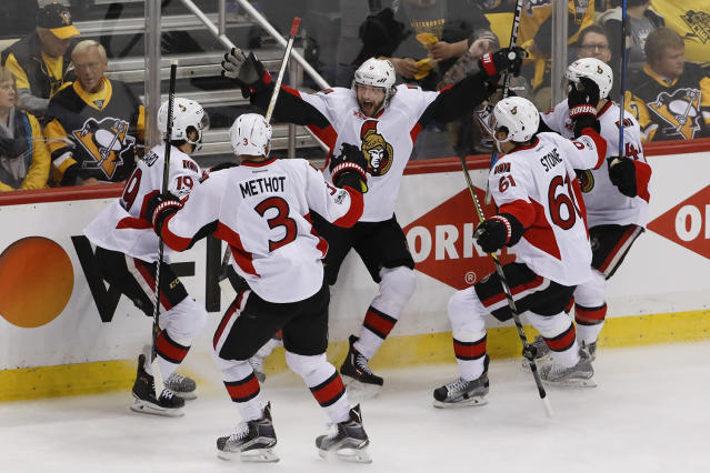 <p>Ottawa Senators' Bobby Ryan, center, celebrates with teammates Marc Methot (3), Derick Brassard (19), Mark Stone (61) and Jean-Gabriel Pageau (44) after scoring the game-winning goal against the Pittsburgh Penguins during the overtime period of Game 1 of the Eastern Conference final in the NHL hockey Stanley Cup playoffs, Saturday, May 13, 2017, in Pittsburgh. Ottawa won 2-1 in overtime. (Photo: Gene J. Puskar/AP) </p>