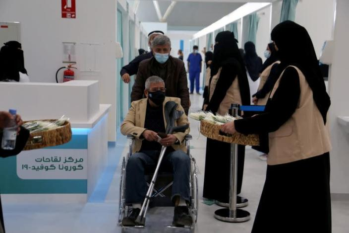 A man in a wheelchair leaving after he received dose of a coronavirus disease (COVID-19) vaccine, in Riyadh