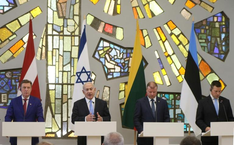 Israel's Benjamin Netanyahu hailed the strong position taken by the Baltic states on anti-Semitism at a news conference with Latvia's Maris Kucinskis (L), Lithuania Saulius Skvernelis and Estonia's Juri Ratas (R)