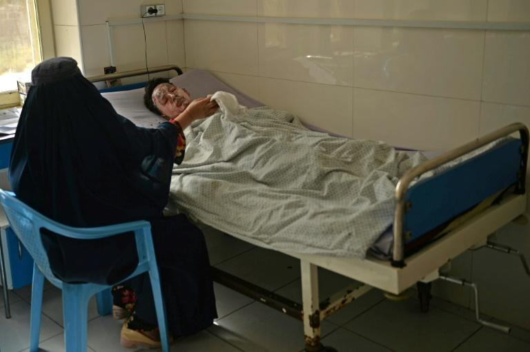 A woman tends to her relative who was injured during the suicide attack (AFP/Hoshang Hashimi)