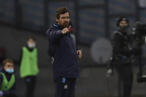 Marseille's head coach Andre Villas-Boas gestures during the French League One soccer match between Marseille and Nimes at the Veledrome stadium in Marseille, France, Saturday, Jan.16, 2021. (AP Photo/Daniel Cole)