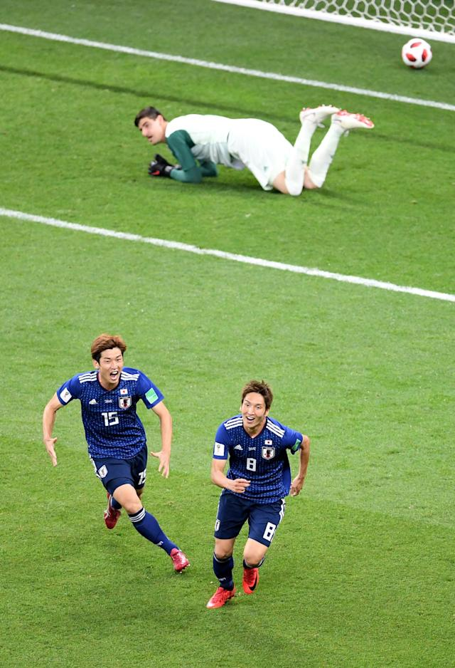 <p>Genki Haraguchi of Japan celebrates with team mate Yuya Osako after scoring his team's first goal during the 2018 FIFA World Cup Russia Round of 16 match between Belgium and Japan at Rostov Arena on July 2, 2018 in Rostov-on-Don, Russia. (Photo by Laurence Griffiths/Getty Images) </p>