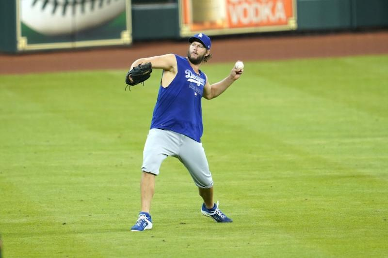 Los Angeles Dodgers pitcher Clayton Kershaw throws during batting practice before a baseball game against the Houston Astros Wednesday, July 29, 2020, in Houston. (AP Photo/David J. Phillip)