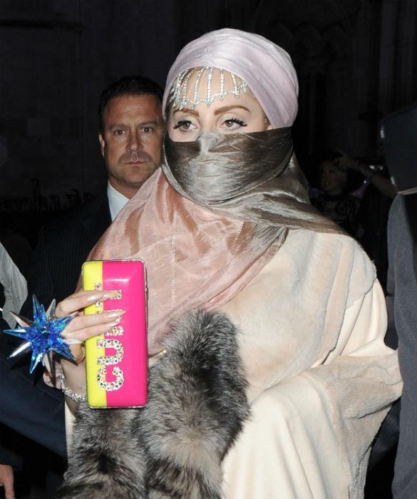 Lady Gaga Wears Outrageous Bag Emblazoned With Swear Word At Philip Treacy SS13 Show